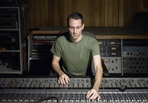 Audio engineer at recording console